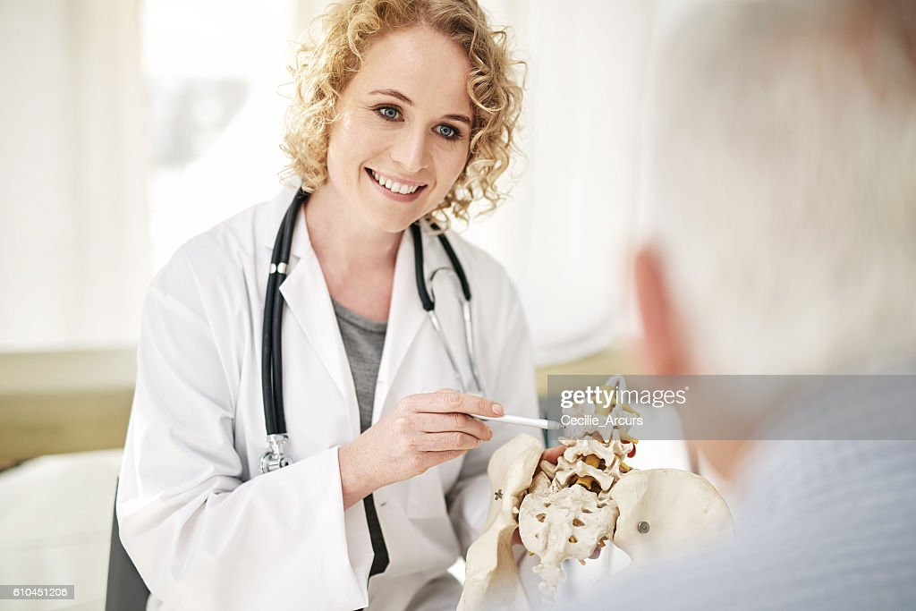 Giving her patient a hands on diagnosis : Stock Photo