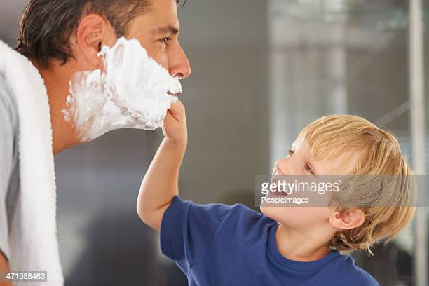 Giving him a clean shave