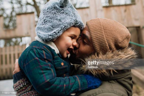 giving his son a kiss on the cheek - candid stock pictures, royalty-free photos & images