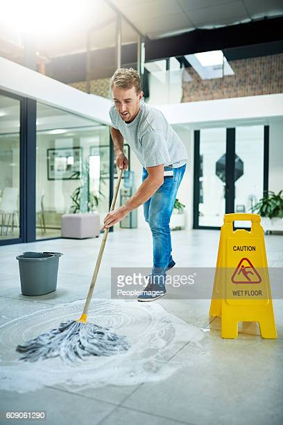 giving it some elbow grease - janitor stock photos and pictures