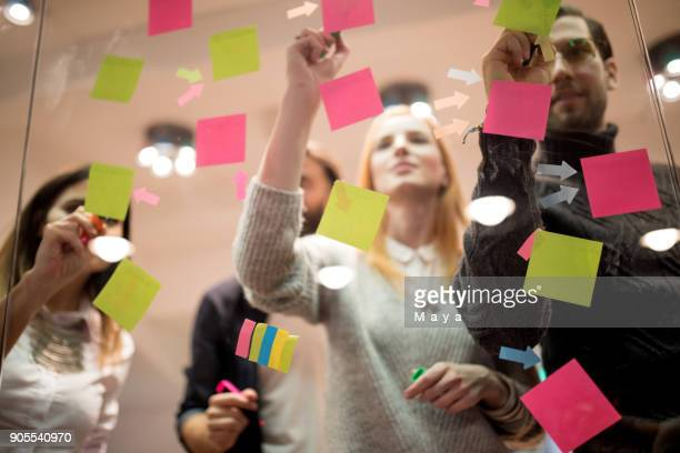 giving motivational sticky notes to out team - adhesive note stock pictures, royalty-free photos & images