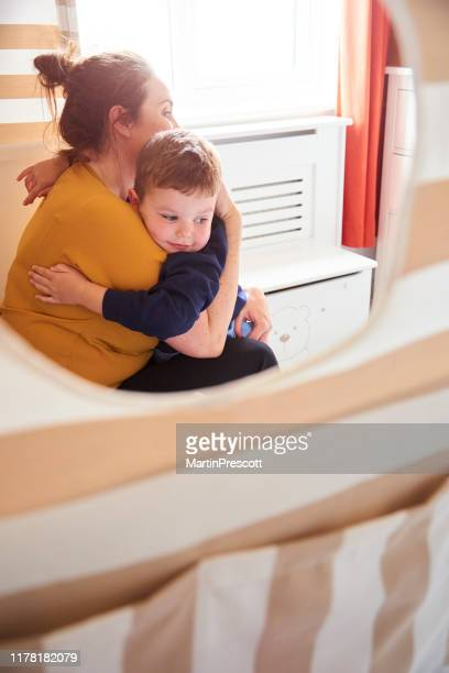 giving mummy a hug before his first day of school - shoulder bag stock pictures, royalty-free photos & images
