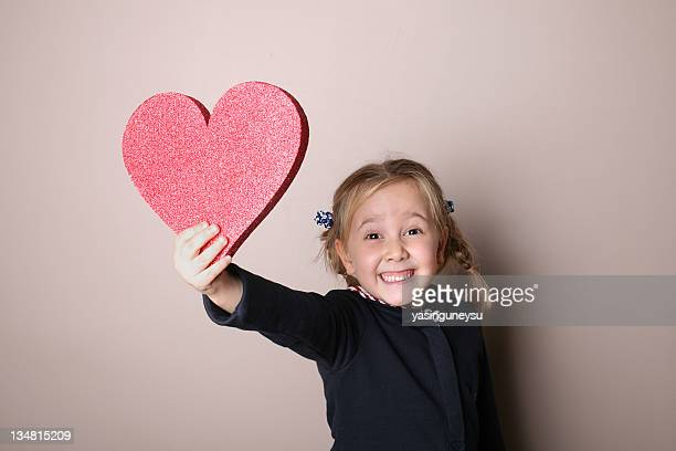 giving my heart - little girl giving head stock photos and pictures