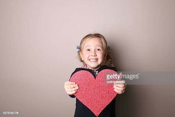 giving my heart - little girls giving head stock photos and pictures