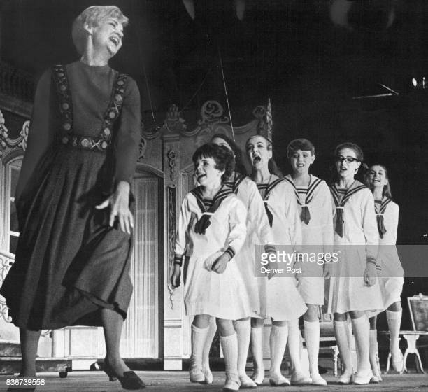Giving out with lusty song from Sound of Music are Wynne Miller who played lead role of Maria Ranier and children of Capt Georg von Trapp From left...