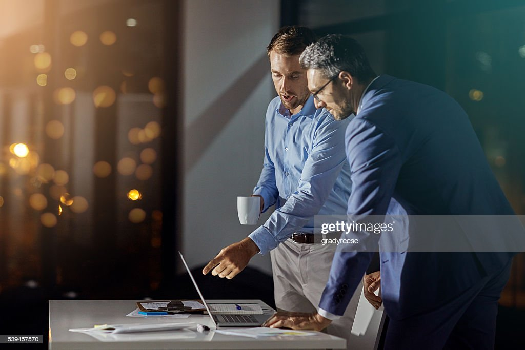 Giving the project all of their attention : Stock Photo