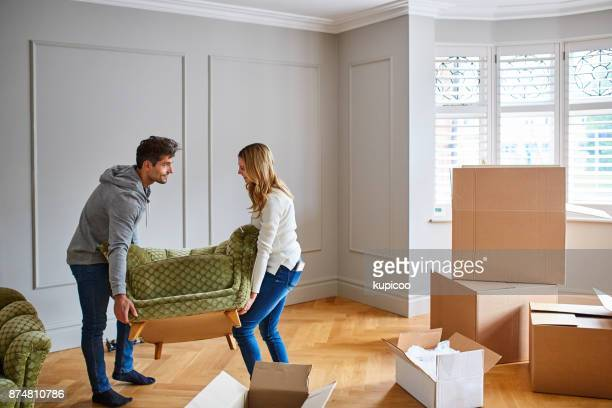 giving their new home a touch of modern flair with stylish furniture - unpacking stock pictures, royalty-free photos & images