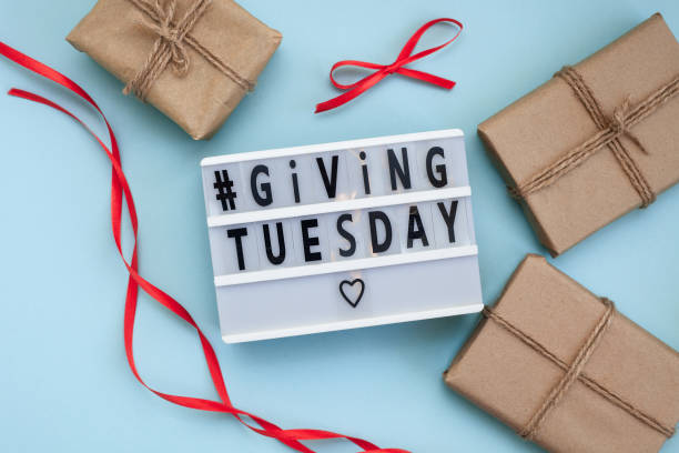 Giving Tuesday text on lightbox. Gift boxes.