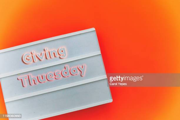 giving tuesday text on lightbox - giving tuesday stock pictures, royalty-free photos & images