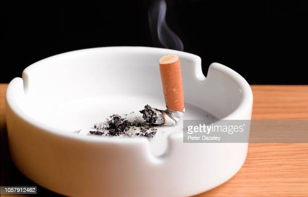 giving up smoking, cigarette butt in ahstray - extinguishing stock pictures, royalty-free photos & images