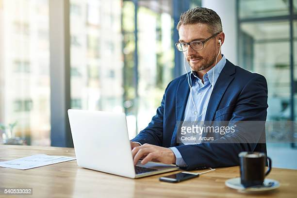 giving work his undivided attention - mid adult stock pictures, royalty-free photos & images