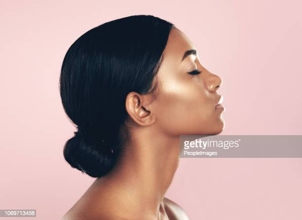 giving you her best side - glowing stock pictures, royalty-free photos & images