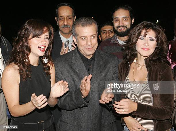 Lebanese actress Noor Egyptian actor Sharif Munir and Egyptian actress Heidi Karam applaud on the first day of shooting of their new film 'Noqtat...