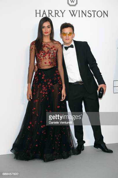 Gizele Oliveira and guest arrive at the amfAR Gala Cannes 2017 at Hotel du CapEdenRoc on May 25 2017 in Cap d'Antibes France