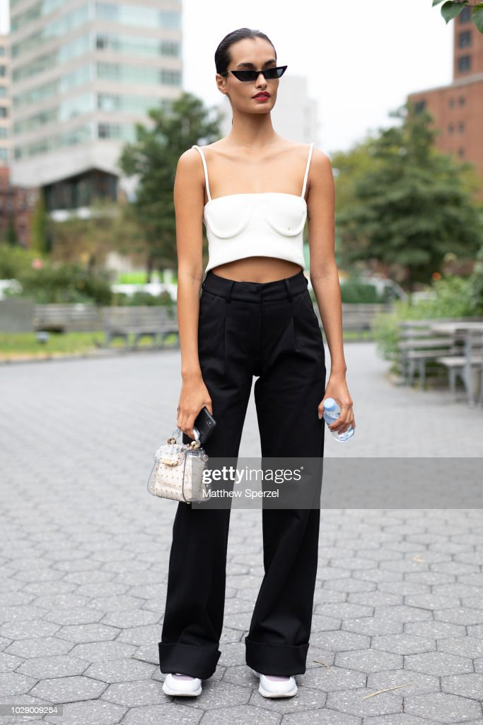 Gizele Oliveira is seen on the street during New York Fashion Week SS19 wearing white top with black pants on September 7, 2018 in New York City.