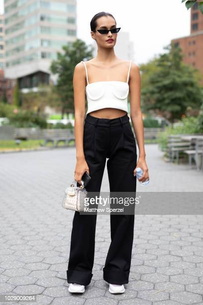 Gizele Oliveira is seen on the street during New York Fashion Week SS19 wearing white top with black pants on September 7 2018 in New York City