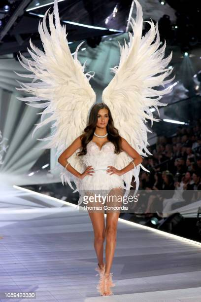 Gizele Oliveira walks the runway wearing Swarovski in the 2018 Victoria's Secret Fashion Show at Pier 94 on November 8 2018 in New York City