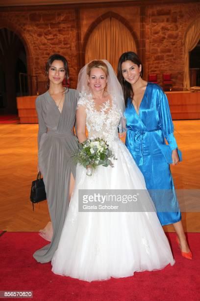 Gizem Emre bride Katja Ohneck and Chryssanthi Kavazi during their church wedding at Heidelberg Castle on September 30 2017 in Heidelberg Germany