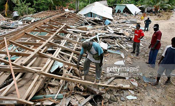 Locals start to clear up the destruction as local communities attempt to rebuild in Gizo after it was hit by a tsunami earlier in the week 07 April...