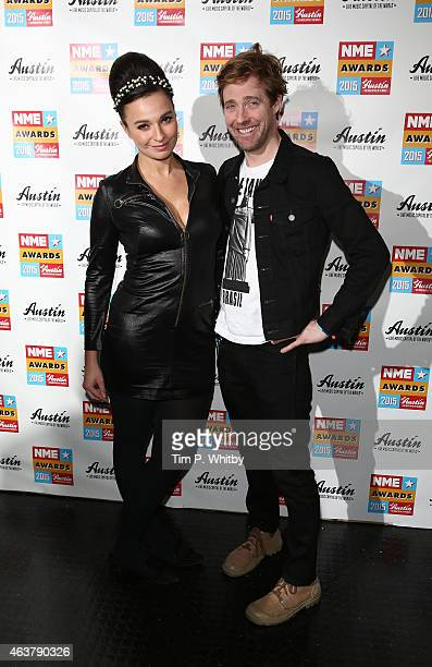 Gizzie Erskine and Ricky Wilson pose in the winner's room at the NME Awards at Brixton Academy on February 18 2015 in London England