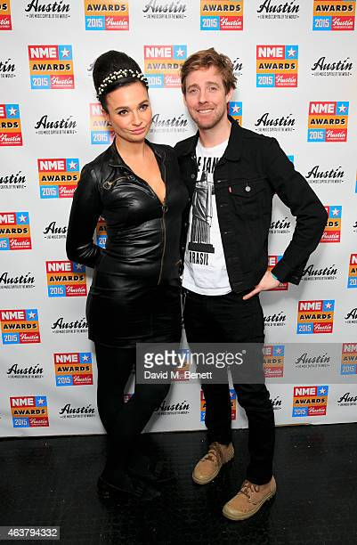 Gizzie Erskine and Ricky Wilson poses in the winner's room at the NME Awards at Brixton Academy on February 18 2015 in London England