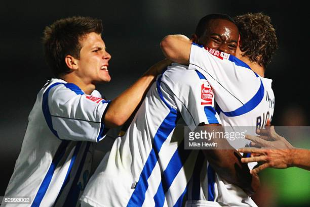 GJoe Anyinsah of Brighton and Hove Albion celebrates with team mates as he scores their second goal during the Carling Cup Second Round match between...