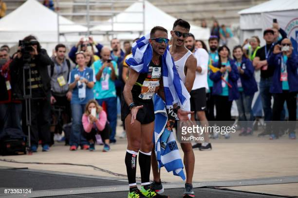 Gkelaouzos Konstantinos and Merousis Hristoforos cheer at the finish line at the 35th Athens Classic Marathon in Athens Greece November 12 2017