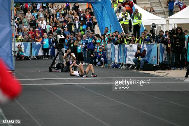 Gkelaouzos Konstantinos crosses the finish line at the Panathenaic stadium at the 35th Athens Classic Marathon in Athens Greece November 12 2017