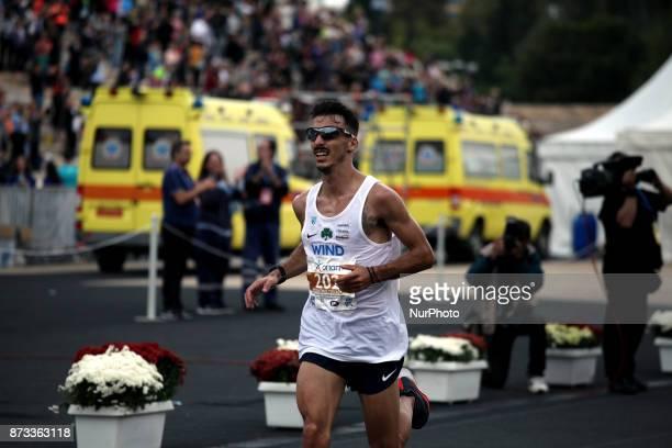 Gkelaouzos Konstantinos enters the Panathenaic stadium at the 35th Athens Classic Marathon in Athens Greece November 12 2017