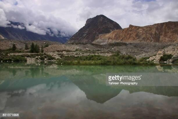 glacial lake at snout of batura glacier - gilgit baltistan stock photos and pictures