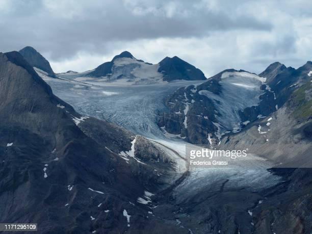 glacial landscape of griesgletscher and griessee from mt. nufenenstock in bedretto valley - gletscher stock-fotos und bilder
