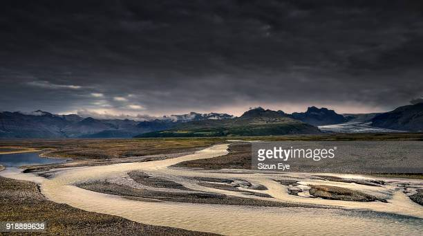 Glacial river comes from the ice cap of Vatnajokull glacier in Southern Iceland.
