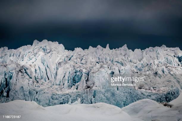 glacier and dark skies - ilulissat stock-fotos und bilder