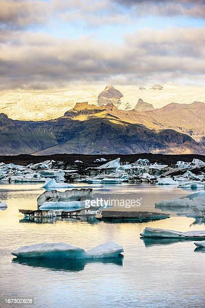 glacier and icebergs at sunrise iceland - jokulsarlon lagoon stock photos and pictures