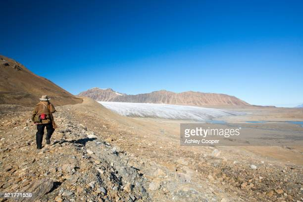 a glacier at recherchefjorden on western svalbard with moraine showing the massive rate of retreat - retreating ストックフォトと画像