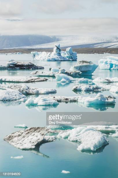 glacier blue lagoon jokulsarlon on skaftafell glacier in iceland. melting glaciers, global warming. - jökulsárlón lagoon stock pictures, royalty-free photos & images
