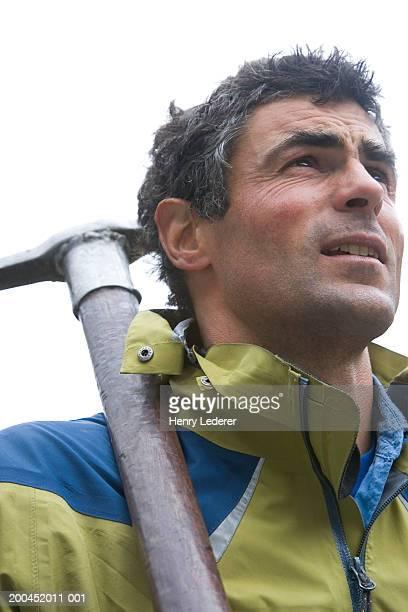 Glacier climber with ice pick