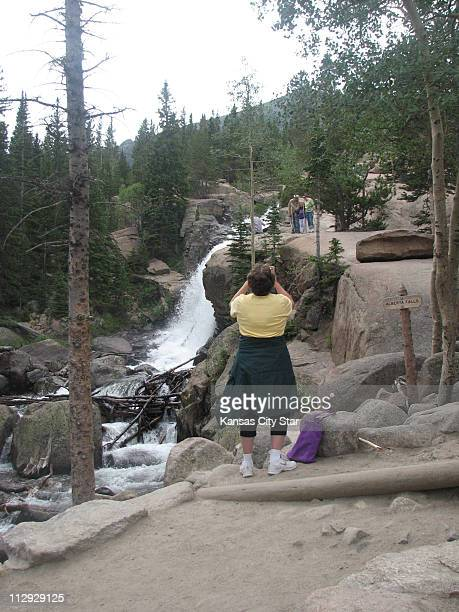 Glacier Creek roars down the rocks at Alberta Falls a popular destination for hikers in the Rocky Mountain National Park in Colorado