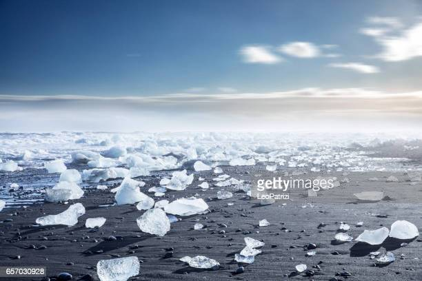 glacier in iceland - blue icebergs floating in the lagoon - glacier lagoon stock photos and pictures