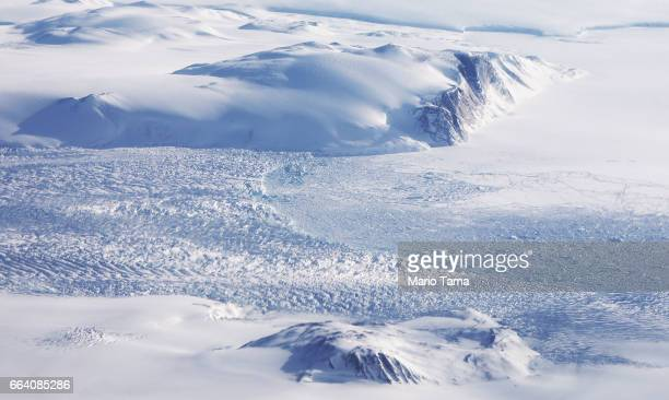 A glacier is seen from NASA's Operation IceBridge research aircraft along the Upper Baffin Bay coast on March 28 2017 above Greenland Greenland's ice...