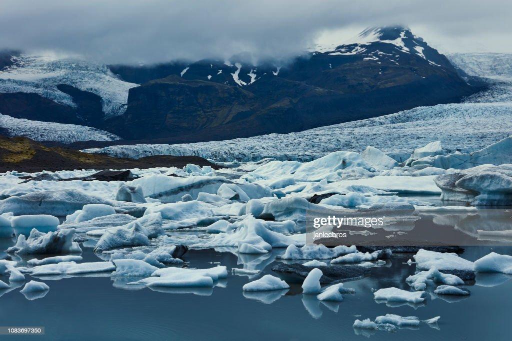 Glacier lagoon in mountains : Stock Photo