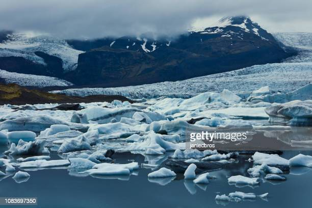 glacier lagoon in mountains - glacier lagoon stock photos and pictures