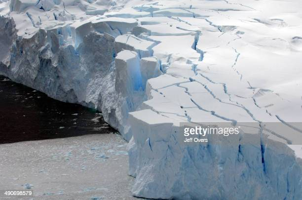 A glacier meets the sea in Neko Harbor on the coast of Graham Land in the Antarctic Peninsula in Antarctica The process of the glaciers reaching the...