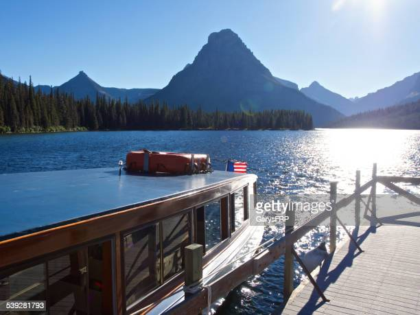 glacier national park two medicine lake historic tour boat sinopah - two medicine lake montana stock photos and pictures