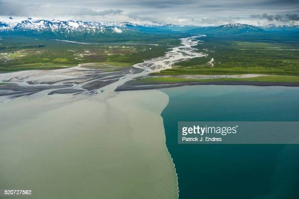 Glacier silt mixes with sea