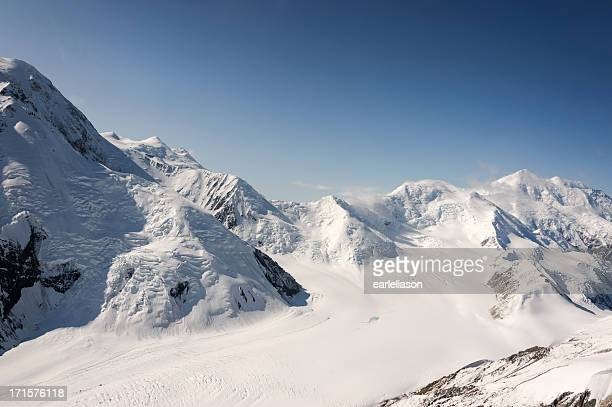 glacier, sky, and mountains - mt mckinley stock photos and pictures