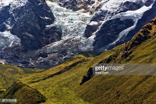 Glaciers and lush hillside seen from Soraypampa basecamp, night one along Salkantay Trek to Machu Picchu, Peru