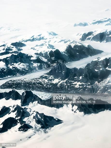 glaciers and snow covered mountains greenland - árido fotografías e imágenes de stock