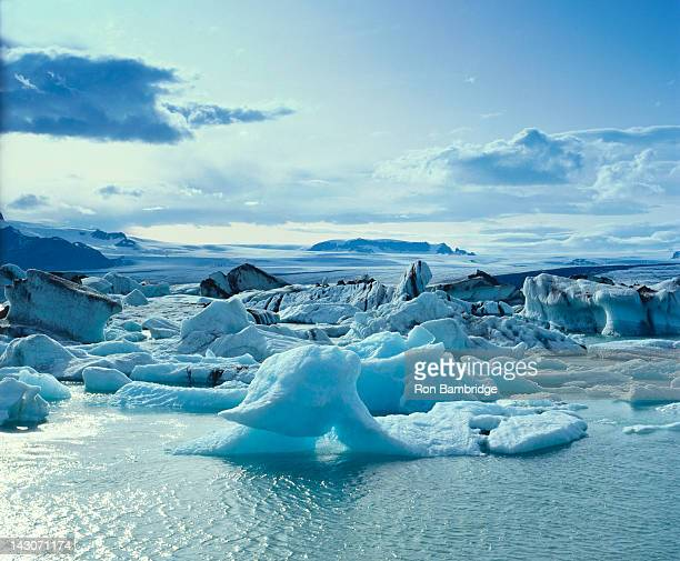 glaciers floating on arctic water - breidamerkurjokull glacier stock photos and pictures