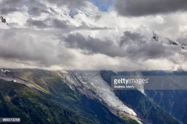 glaciers flowing from mont blanc into chamonix valley and through a layer of clouds - pinnacle peak stock pictures, royalty-free photos & images
